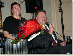 Elizabeth Davis, founder of EAD & Associates, receiving the Progressive Center for Independent Living's Leadership Award. Presenting the award is PCIL's Executive Director Scott Elliott.